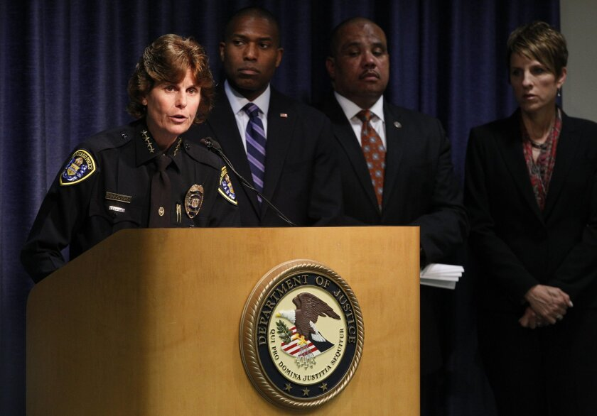 San Diego Police Chief Shelley Zimmerman announces that the Department of Justice will do an audit of the San Diego Police Department. Behind her are DOJ and SDPD officials, including U.S. Attorney Laura Duffy (R).