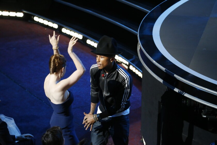 """Pharrell Williams, dancing with Amy Adams as he works the crowd, sings """"Happy"""" from """"Despicable Me 2."""""""