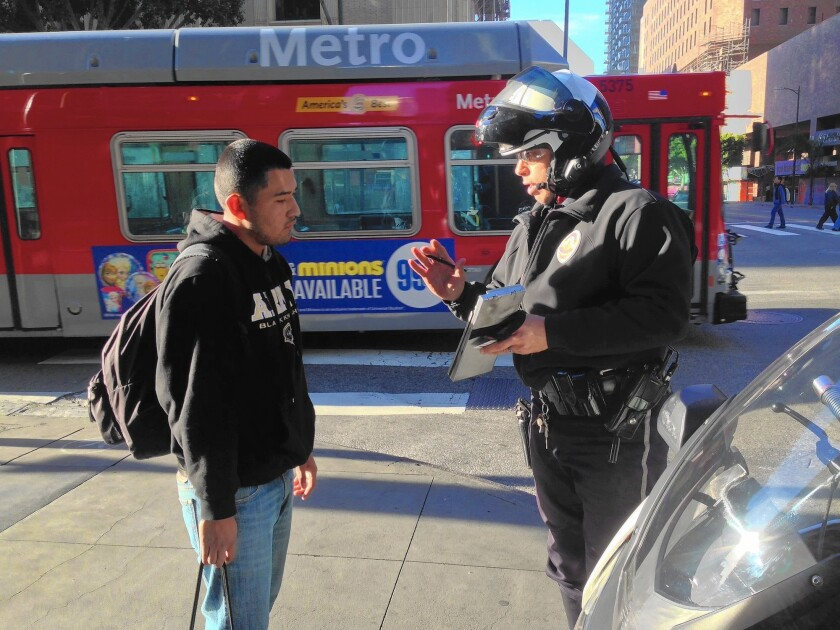 Eduardo Lopez gets a citation from Officer Robert Lockhart.