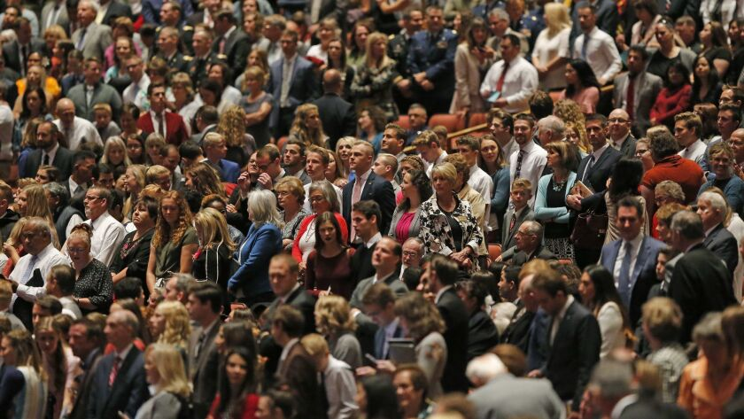 People attend during the twice-annual conference of The Church of Jesus Christ of Latter-day Saints