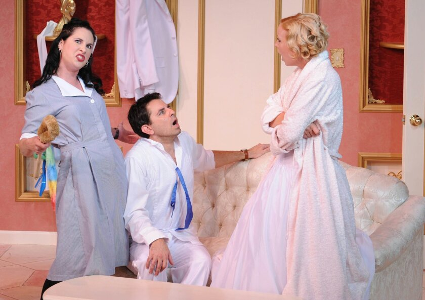 "Kerry McCue as Julie, Christopher M. Williams as Bill and Amanda Schaar as Racheal in North Coast Repertory Theatre's ""Perfect Wedding."" KEN JACQUES"
