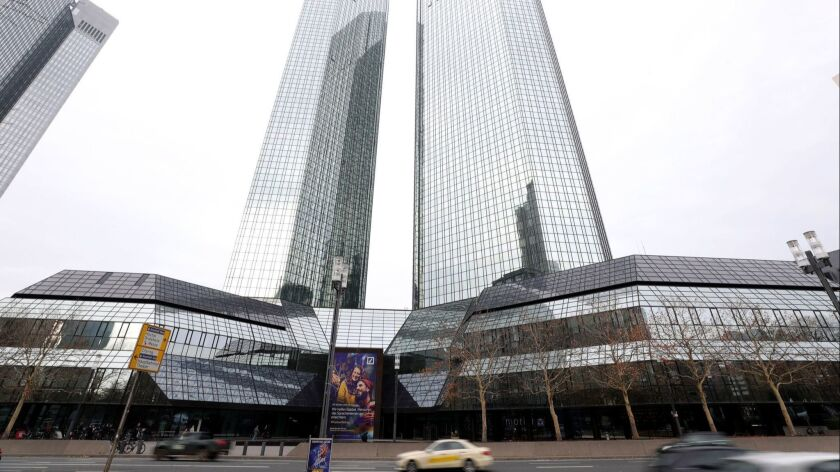 Deutsche Bank's headquarters in Frankfurt, Germany, shown last week, were raided by German authorities Thursday in connection with a money-laundering investigation prompted by disclosures in the Panama Papers.