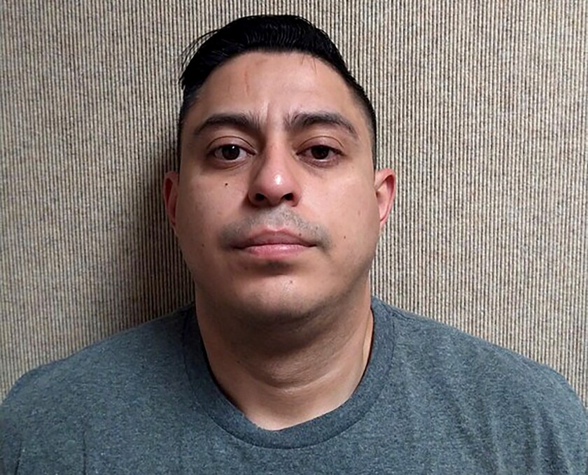 This undated photo released by the Fontana, Calif., Police Department shows Alonso Calle. Calle, an Uber driver, was arrested on suspicion of raping a woman who said she fell asleep in his car after a night of drinking and woke up to him assaulting her, authorities said. Calle had contacted police and said he was the accused Uber driver, but claimed he had consensual sex with the woman in Fontana early Sunday, Jan. 12, 2020, police said in a statement. Detectives interviewed Calle, 32, then arrested him. (Fontana Police Department via AP)