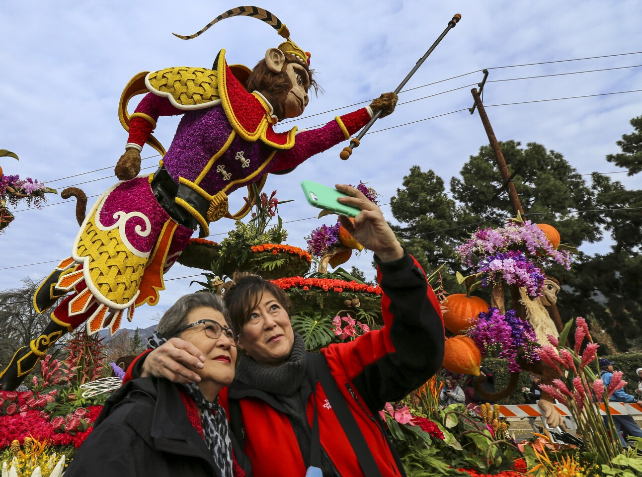 Natalie Nakatani, right, takes a selfie with her mother, Fujiko Nakatani, at the Showcase of Floats, where visitors were able to get an up-close view of Rose Parade floats Tuesday morning.