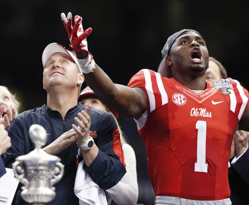 Mississippi wide receiver Laquon Treadwell (1) reacts with head coach Hugh Freeze after their victory over Oklahoma State in the Sugar Bowl college football game in New Orleans, Friday, Jan. 1, 2016. Mississippi won 48-20. (AP Photo/Bill Feig)