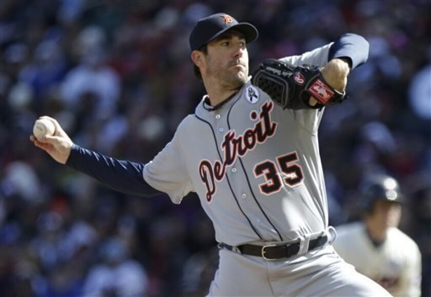 Detroit Tigers pitcher Justin Verlander pitches in the first inning of the Twins opening day baseball game Monday, April 1, 2013 in Minneapolis. (AP Photo/Jim Mone)