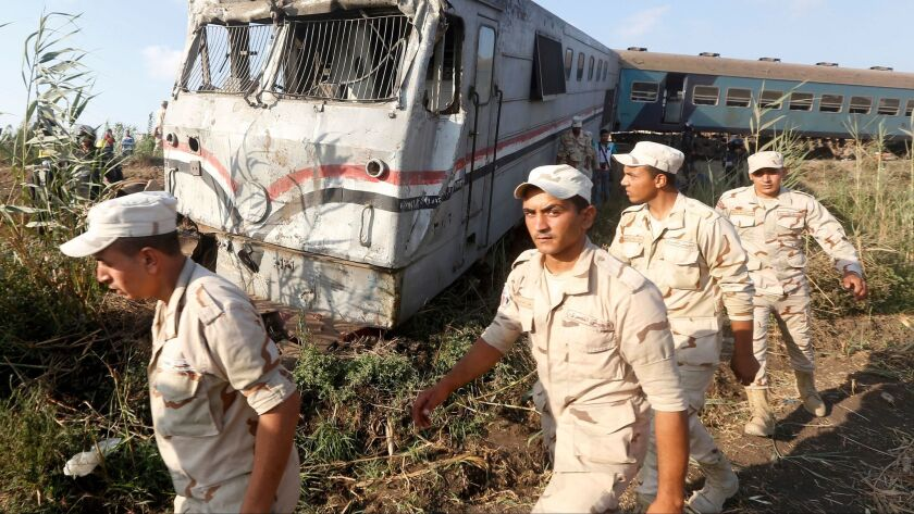 Army attend the scene of a train collision just outside Egypt's Mediterranean port city of Alexand