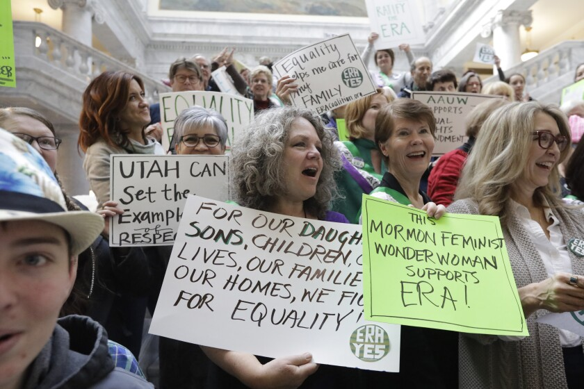 This Tuesday, Dec. 3, 2019, photo, supporters of the Equal Rights Amendment as they rally at the Utah State Capitol, in Salt Lake City. The renewed national push to ratify the Equal Rights Amendment is coming to conservative Utah, where supporters are launching a long-shot bid to challenge Virginia in becoming a potential tipping point despite opposition from the influential Church of Jesus Christ of Latter-day Saints. (AP Photo/Rick Bowmer)