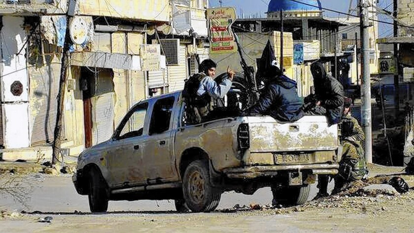 Members of the Islamic State of Iraq and Syria, seen in an image on a militant website, have become entrenched in Syria's Raqqah province. The militant group carries out whippings and public executions for violations of its strict Islamic edicts.