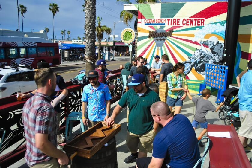 The outdoor patio at Kilowatt features games for kids of all ages.