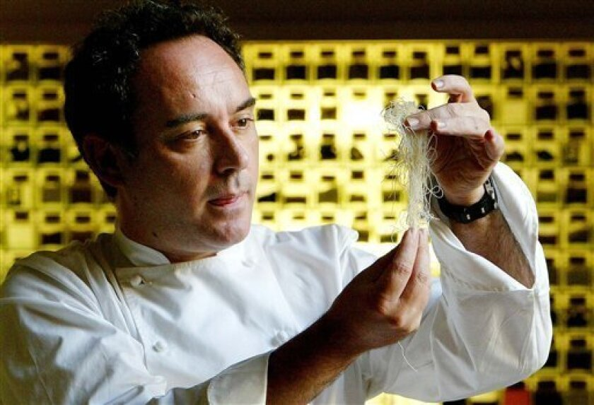 FILE - In this Dec. 5, 2003 file photo, Spanish chef Ferran Adria examines ingredients in his kitchen workshop in Barcelona, Spain. Spain's famous elBulli restaurant will temporarily reopen later this year as the renowned chef-owner Adria trains actors for a movie based on his iconic but shuttered