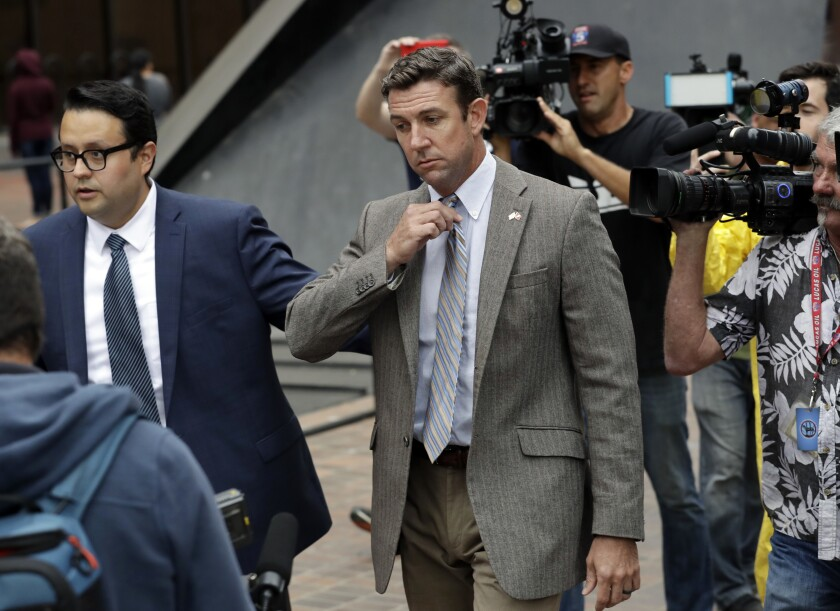 U.S. Rep. Duncan Hunter, center, leaves court Monday, Sept. 24, 2018, in San Diego.