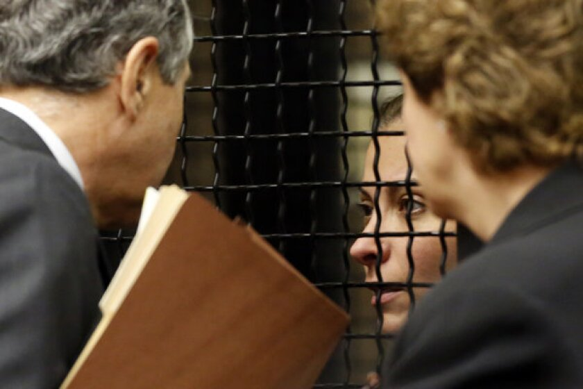 Saudi princess Meshael Alayban, 42, listens to her attorneys during her appearance in Santa Ana court.