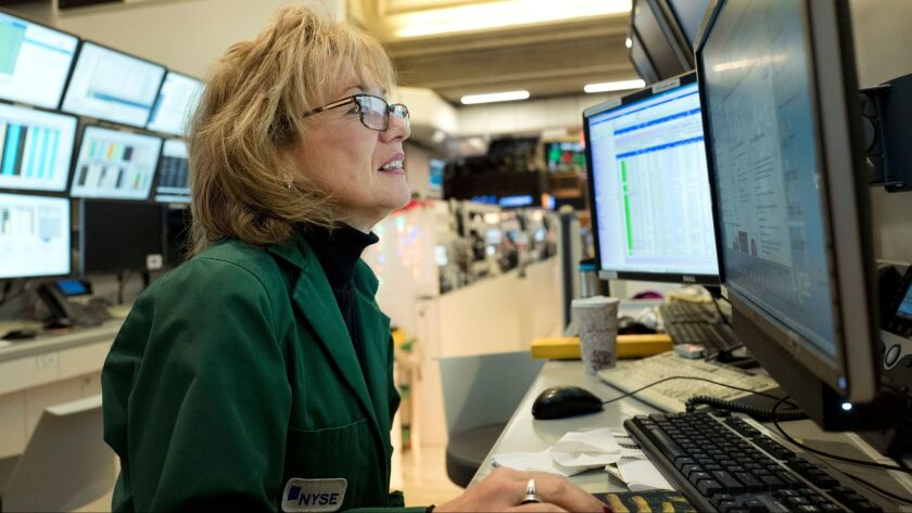 Maria Averna, a lead supervisor for New York Stock Exchange Operations, monitors trading at the exch