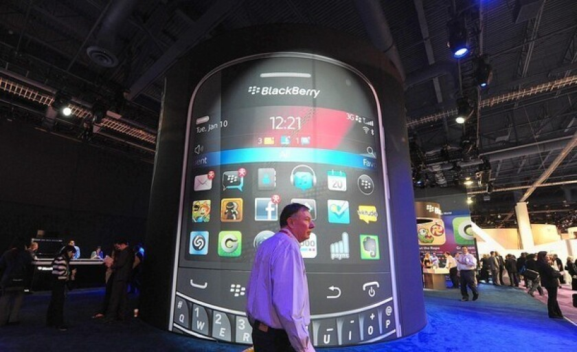 Apple and Samsung's combined smartphone unit sales in the second quarter rose 43% year over year as sales for other brands fell 16%. BlackBerry and Nokia didn't even make the top five brands in the U.S. Above, A man passes by a BlackBerry display in January at the International Consumer Electronics Show in Las Vegas.