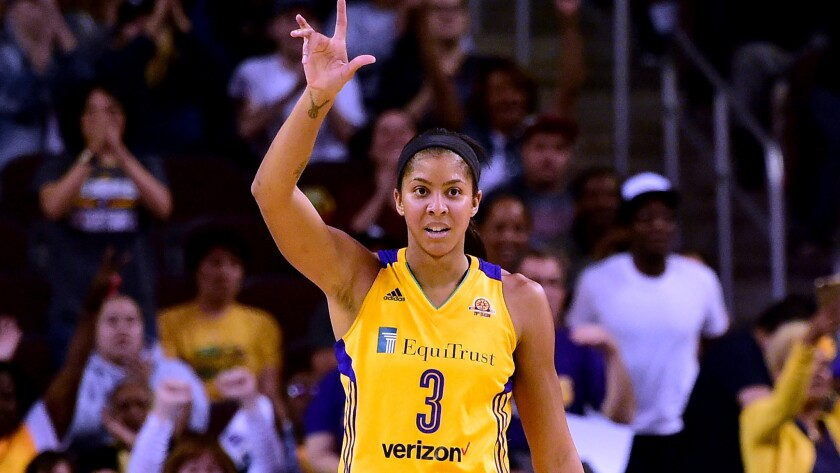 Sparks forward Candace Parker reacts after assisting on a teammate's basket during a Game 3 victory over the Minnesota Lynx on Friday night.