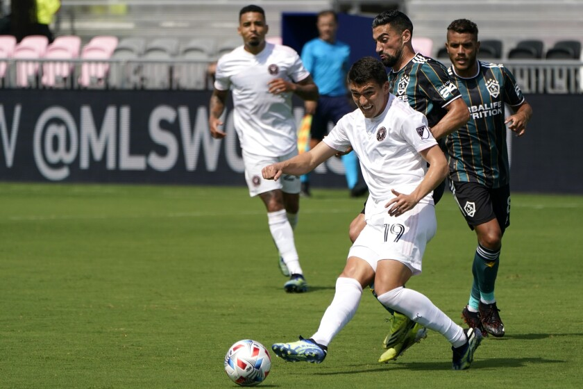 Inter Miami forward Robbie Robinson (19) kicks the ball during the first half of an MLS soccer match against LA Galaxy, Sunday, April 18, 2021, in Fort Lauderdale, Fla. (AP Photo/Lynne Sladky)