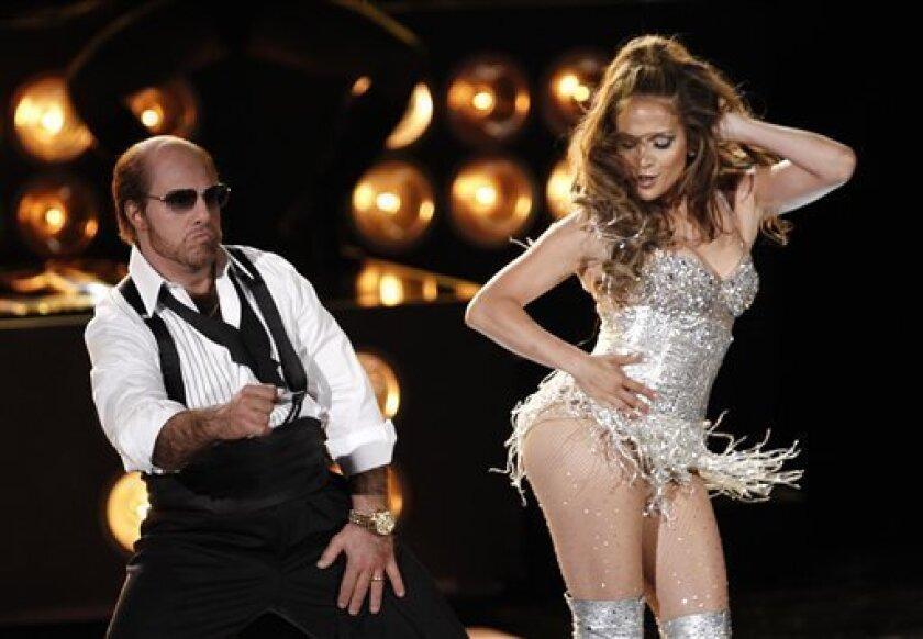 Tom Cruise, left, and Jennifer Lopez perform at the MTV Movie Awards in Universal City, Calif., on Sunday, June 6, 2010. (AP Photo/Matt Sayles)