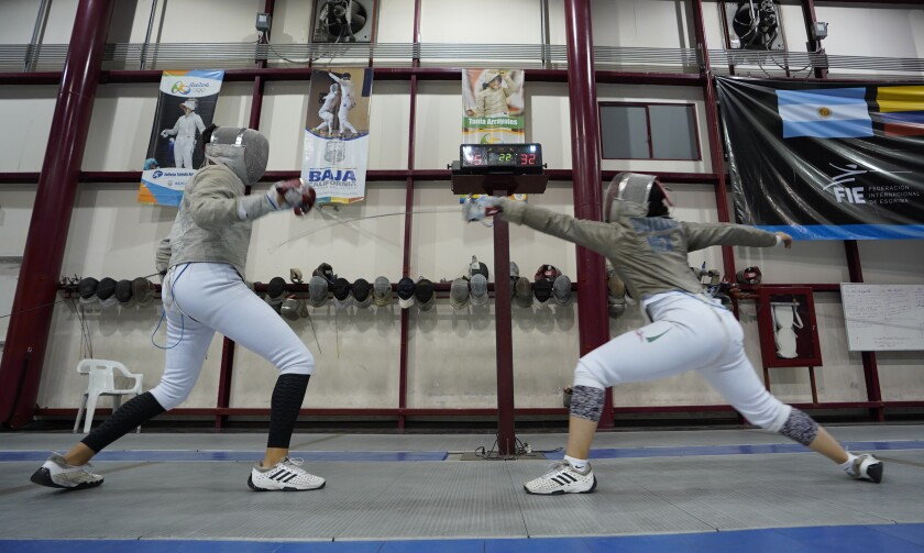 Aryadna Alcantar, 17, left, trains with Natalia Botello, 17, at the Centro de Alto Rendimiento, CAR in Tijuana.