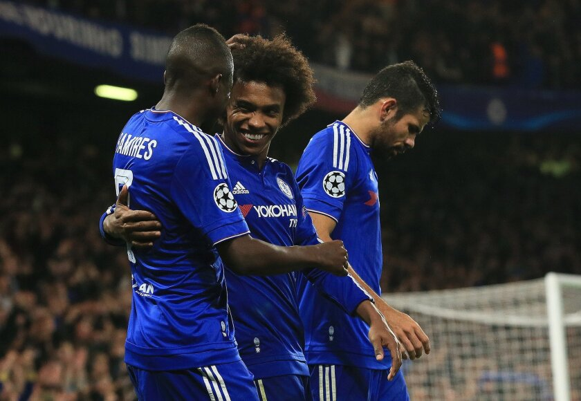 Chelsea's Willian, center, celebrates with Ramires, left, and Diego Costa after scoring the winning goal during the Champions League Group G soccer match between Chelsea and Dynamo Kiev at Stamford Bridge Stadium in London,  Wednesday, Nov. 4, 2015. (AP Photo/Tim Ireland)