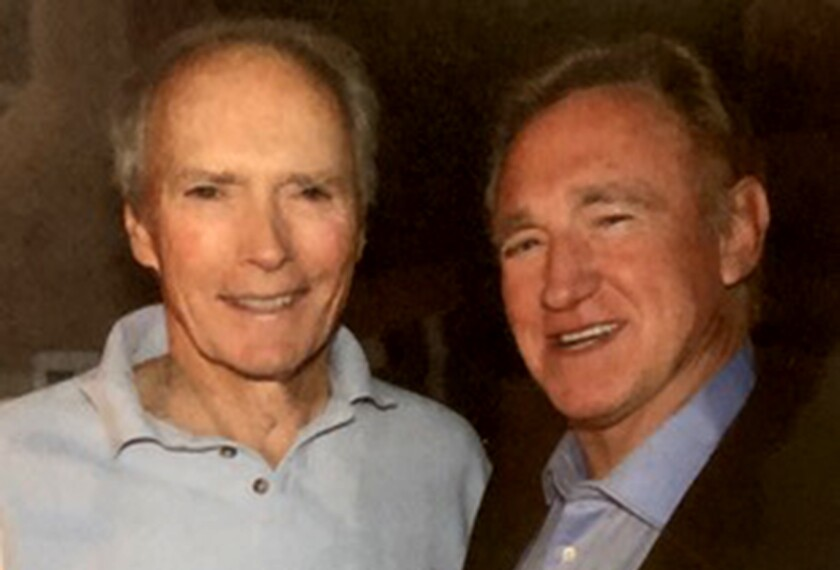 l/r Clint Eastwood and David Sheehan in handout photo for a Susan King Classic Hollywood feature on