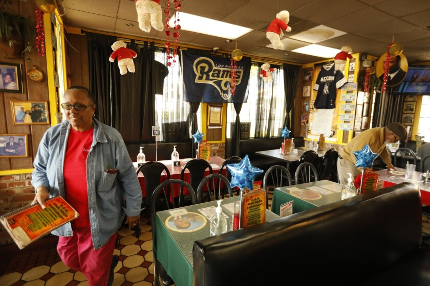INGLEWOOD, CA - JANUARY 30, 2019 - - Beverly Brinson, owner of Ms. B's M&M Soul Food, sets up party