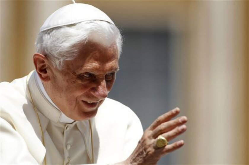 Pope Benedict XVI blesses the faithful during his weekly general audience in St. Peter's Square at the Vatican, Wednesday, June 1, 2011. (AP Photo/Andrew Medichini)