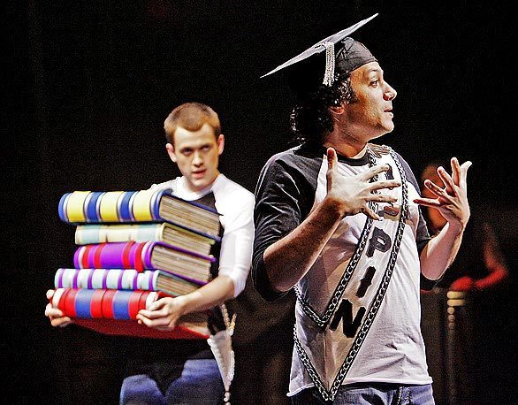 """Michael Arden, left, and Tyrone Giordano are voice and sign-language counterparts in their dual portrayal of the title character in """"Pippin."""" Deaf West Theatre and Center Theatre Group have partnered to put together a sound and sign-language rendition of the 1970s musical with score by Stephen Schwartz (""""Wicked"""") and book by Roger O. Hirson. It's at the Mark Taper Forum through March 15."""