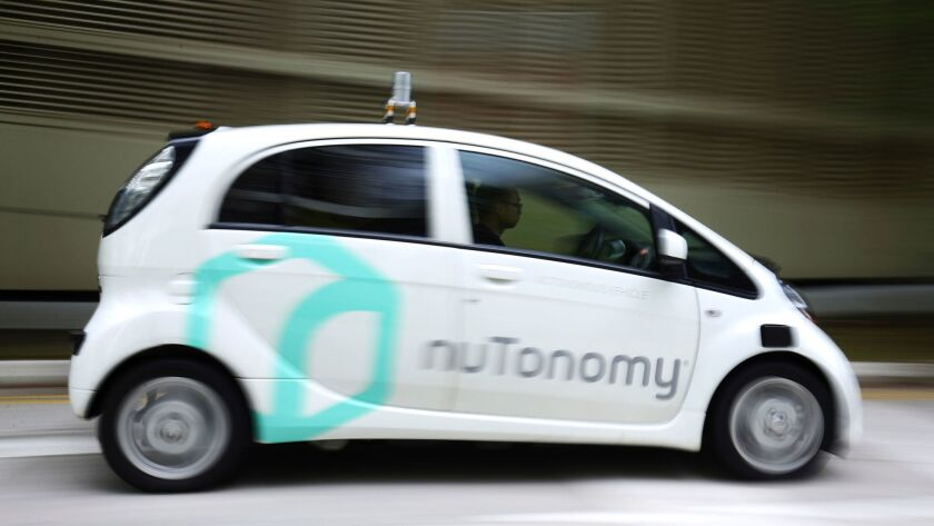 FILE - In this Wednesday, Aug. 24, 2016, file photo, an autonomous vehicle, operated by nuTonomy, is