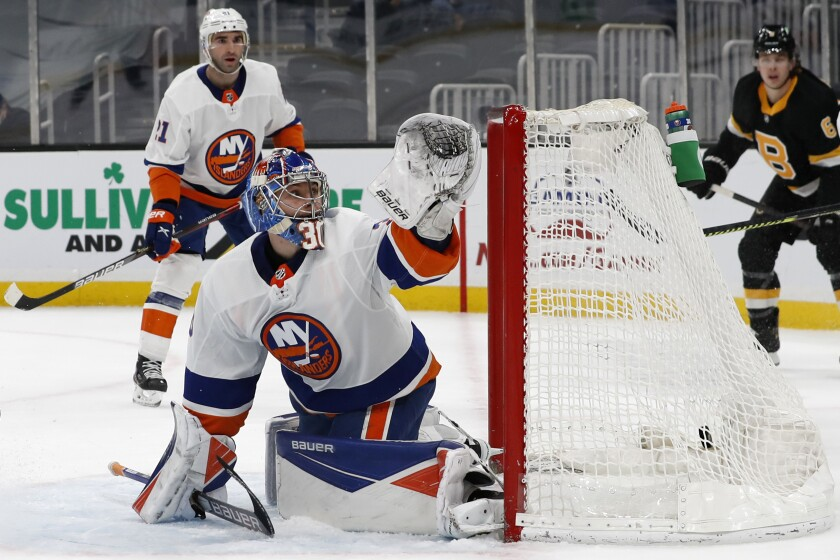 New York Islanders goaltender Ilya Sorokin can't stop a goal by Boston Bruins' David Pastrnak during the first period of an NHL hockey game Friday, April 16, 2021, in Boston. (AP Photo/Winslow Townson)