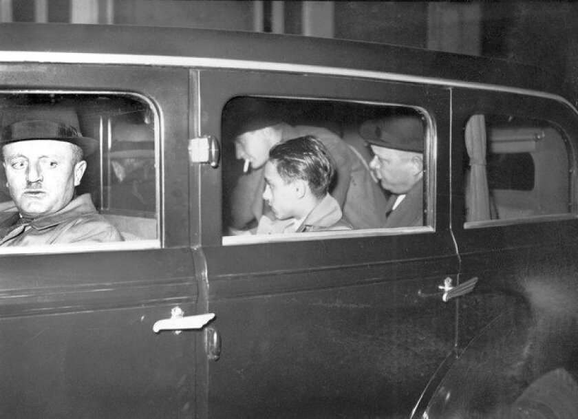 Herschel Grynszpan is escorted by French policemen Dec. 2, 1938, to Paris court.