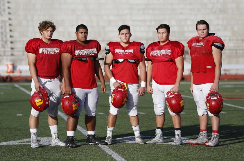 In a photo from last season, Cathedral Catholic offensive lineman Logan Berzins (far left) and his teammates have a special feeling about the Honor Bowl.