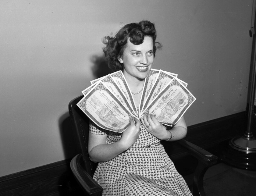 Aug. 9, 1943: Joyce Davis holds Victory Bond notes