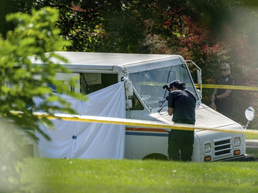 Police investigate the scene of a fatal shooting of a postal worker in front of a house on Suburban Ave. in Collier Township, Pa., outside of Pittsburgh, on Thursday, Oct. 7, 2021. (Andrew Rush/Pittsburgh Post-Gazette via AP)