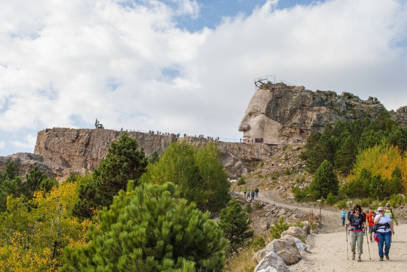 The Autumn Volksmarch, 2014. Twice each year, in spring and fall, thousands of hikers make the 6.2-mile round-trip trek from the base of the mountain to the top of the Crazy Horse Memorial.