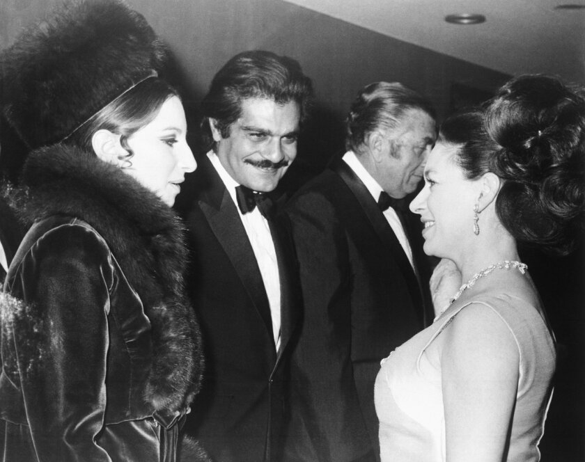 "FILE - In this Jan. 15, 1969 file photo, Britain's Princess Margaret, right, talks with American singer Barbra Streisand, left, and actor Omar Sharif, center, at the premiere of the film ""Funny Girl,"" at the Odeon Cinema, London. Sharif has died in a Cairo hospital of a heart attack, his agent said on Friday, July 10, 2015. (AP Photo, File)"