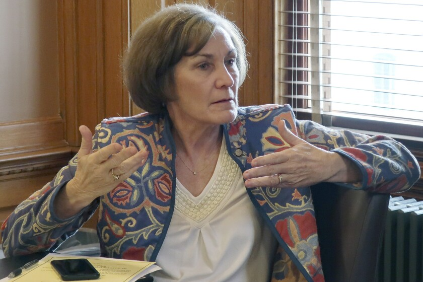 FILE - In this Feb. 13, 2019, file photo, state Sen. Barbara Bollier, D-Mission Hills, speaks during a meeting of Democratic senators at the Statehouse in Topeka, Kan. Bollier, a Kansas legislator who defected from the Republican Party last year, is running for the U.S. Senate next year as a Democrat. Bollier raised $2.35 million during the first three months of 2020 given that the potential GOP frontrunner to replace retiring Republican Sen. Pat Roberts is prominent conservative Kris Kobach. (AP Photo/John Hanna File)