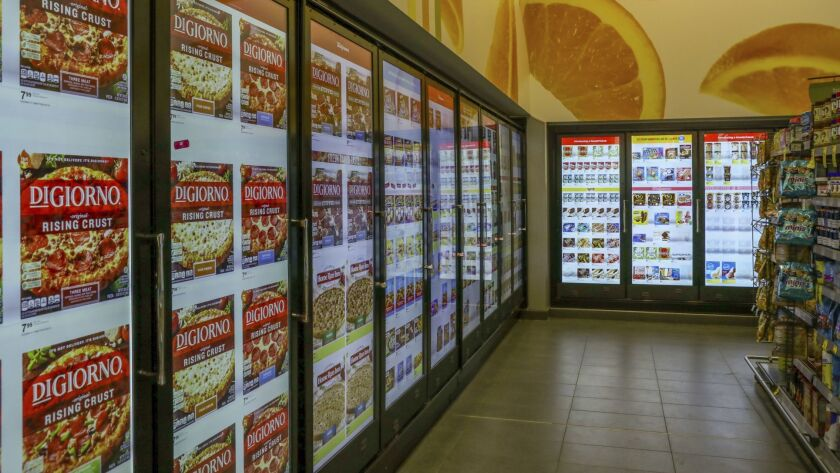 At this Walgreen's in Chicago, a smart-shelf area has cooler doors with cameras and sensors. The doors' video screens display images of the coolers' contents and could show ads as well.