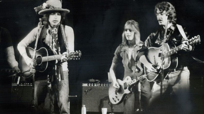 Bob Dylan, left, performed in Toronto in 1975 with a host of musicians, including Mick Ronson, center, and Bobby Neuwirth. Others at the show included Joni Mitchell, Joan Baez, Ramblin' Jack Elliott, Ronee Blakley, Roger McGuinn and Gordon Lightfoot.