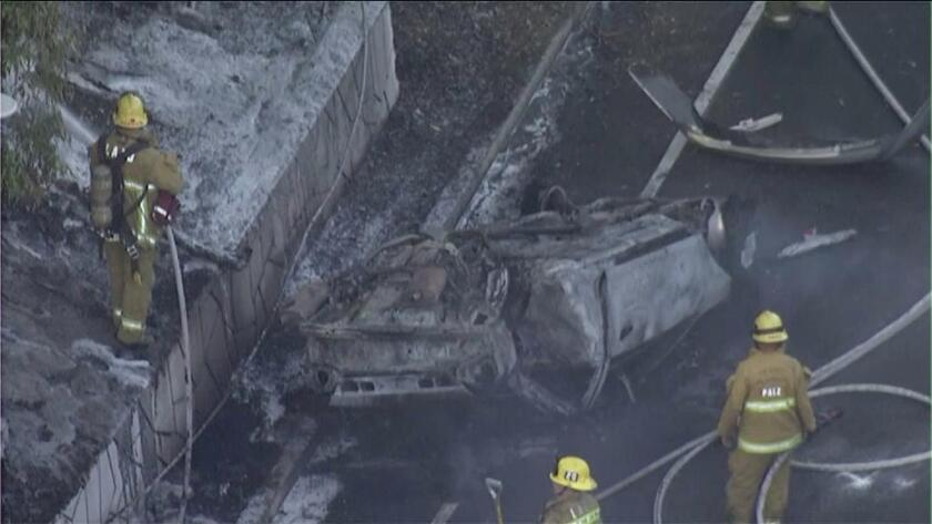 A small vegetation fire was sparked after a fatal single-car crash on the 110 Freeway near downtown Tuesday morning.