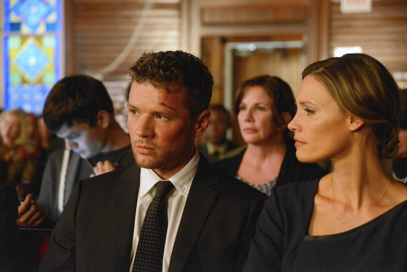 Ben (Ryan Phillippe, with Kadee Strickland) comes under intense scrutiny after finding a dead body.