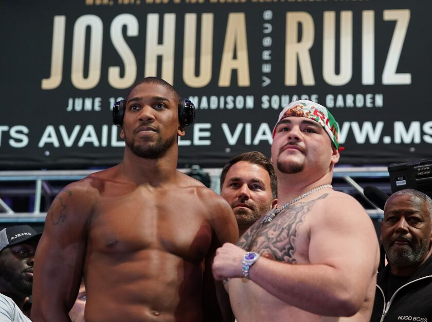 World heavyweight boxing champion Anthony Joshua (L) of England and Mexican-American Andy Ruiz Jr. pose during their weigh-in at Madison Square Garden in New York, May 31, 2019. - Joshua faces challenger Ruiz on June 1, 2019 at Madison Square Garden in New York. (Photo by TIMOTHY A. CLARY / AFP)TIMOTHY A. CLARY/AFP/Getty Images ** OUTS - ELSENT, FPG, CM - OUTS * NM, PH, VA if sourced by CT, LA or MoD **