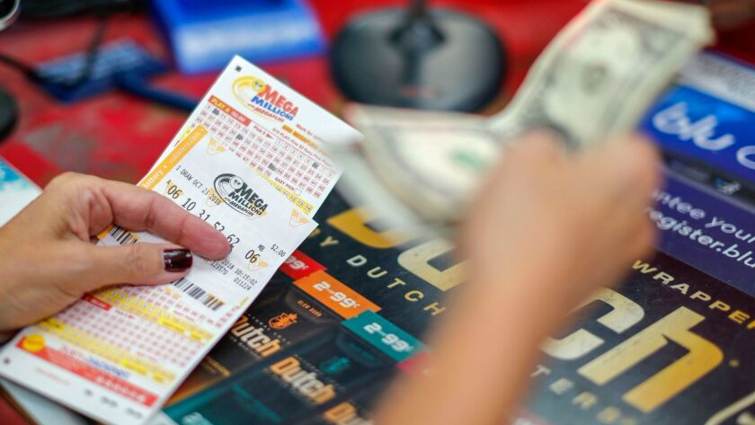 A customer purchases Mega Millions lottery tickets at a retailer in Arlington, Va., on Monday.