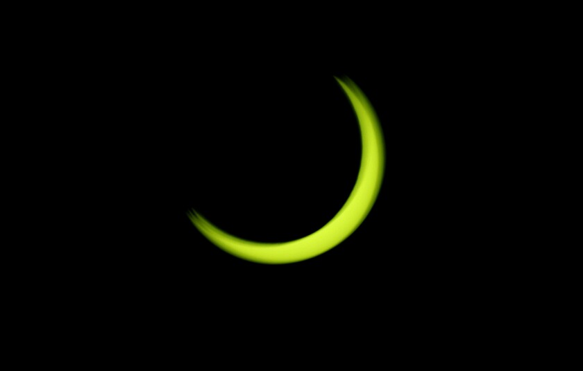 The so-called annular eclipse leaves a thin outer ring of the sun visible.