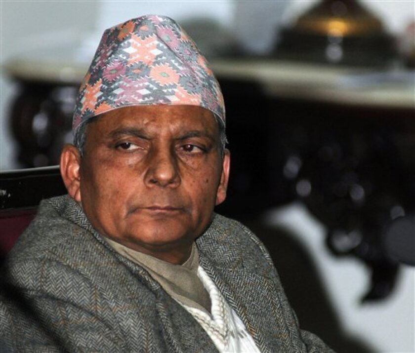FILE - In this Feb. 17, 2013 file photo, Nepal's Chief Justice Khilraj Regmi attends a meeting in Katmandu, Nepal. Regmi will be sworn in Thursday, March 14, 2013 as the head of a new interim government that would be given the task of holding elections in three months, officials said.(AP Photo/File)
