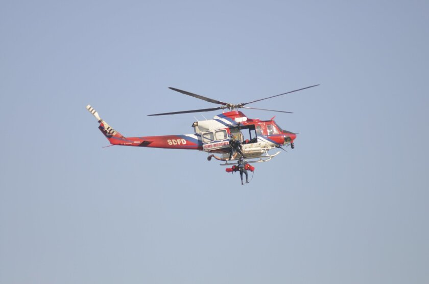 San Diego Fire-Rescue Department used a helicopter to retrieve the body of a hiker from a trail midway down the cliff from the Torrey Pines Gliderport last year.