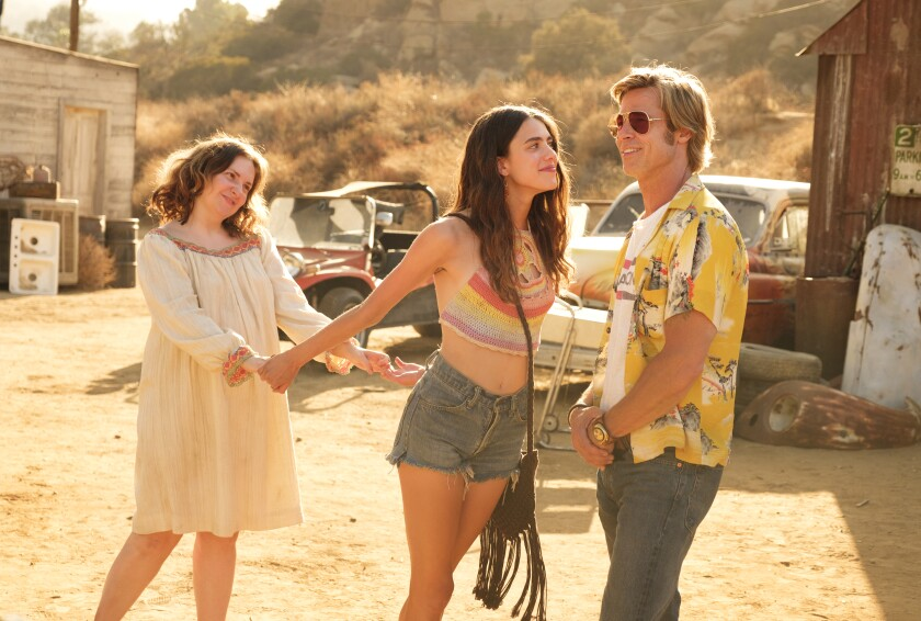 "Lena Dunham, left, Margaret Qualley and Brad Pitt star in ""Once Upon a Time... in Hollywood."""