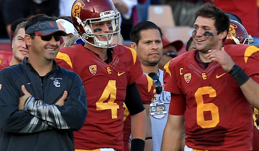 Max Browne (4) is among the candidates to be the backup to starting quarterback Cody Kessler (6) next season.