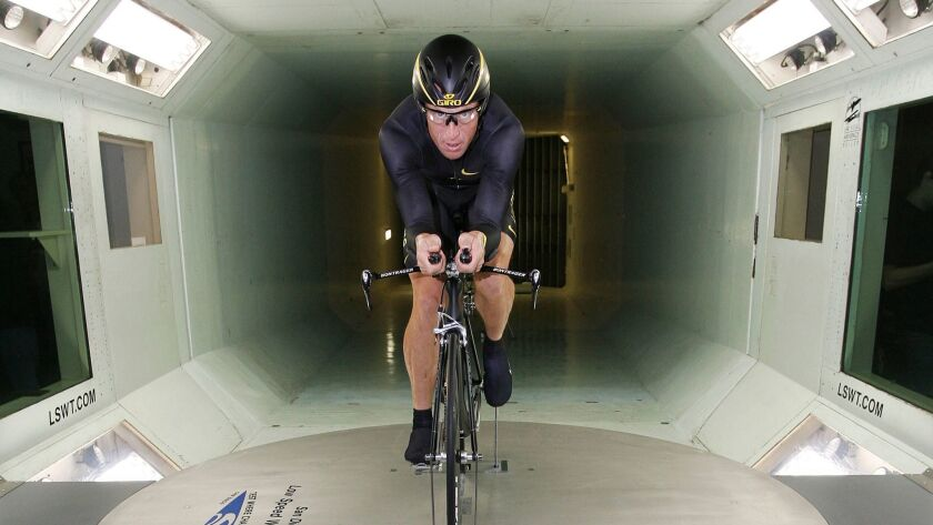 Cyclist Lance Armstrong warms up before riding a Trek prototype bicycle at the wind tunnel in 2008.