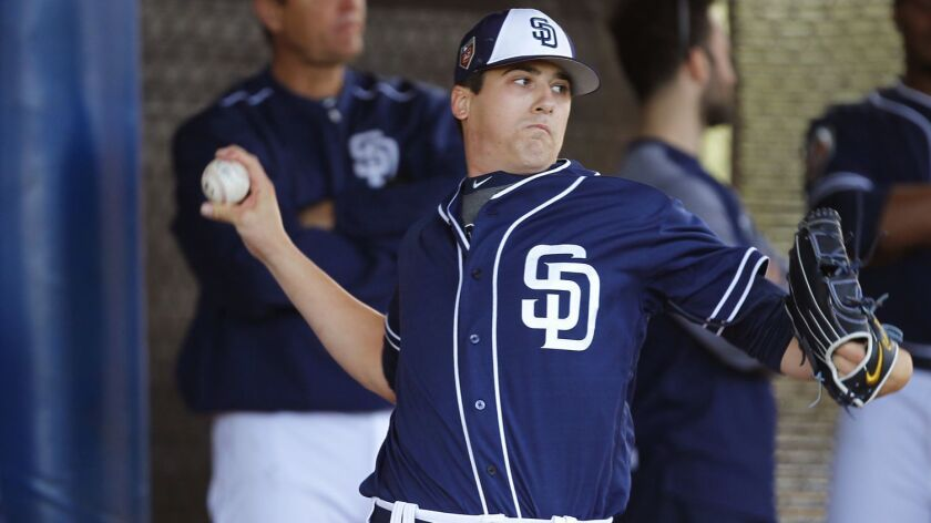 Padres pitcher Cal Quantrill throws during a spring training practice in Peoria on Feb. 19, 2018.